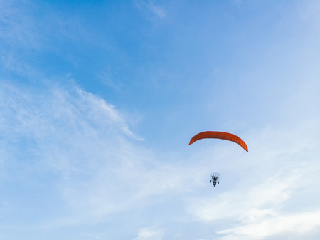 man ride Paramotor flying in the sky Banco de Imagens