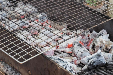 metal grate: Charcoal metal stove with grill grate ready to cook