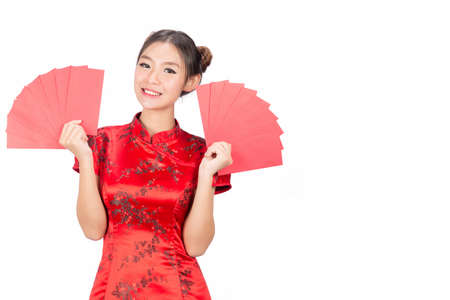 Asian girl in traditional and take Red envelopes chinese new year,Concept celebrating Chinese Lunar New Year or spring festival, ,isolated on white background.