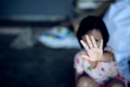 abusedabused woman, child, child bondage in angle of abandoned building , stop violence against Women, international women's day
