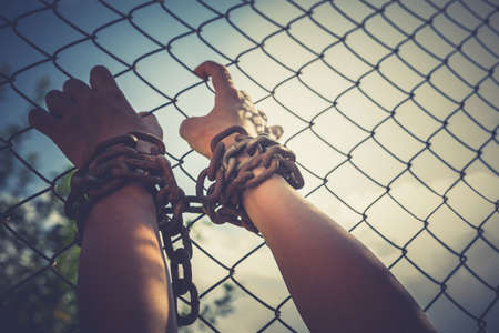 vintage tone of Shot focus blur of hand of Woman chained Stock Photo