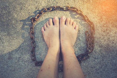 vintage tone of Shot focus of  Foot of Woman  Liberation from the chains