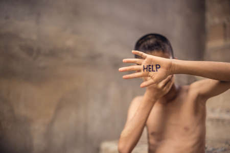Stop abusing violence. violence, terrified , A fearful child Stock Photo