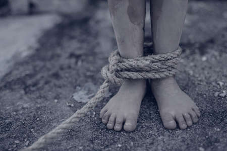 boy of a victim tied up with rope Banque d'images