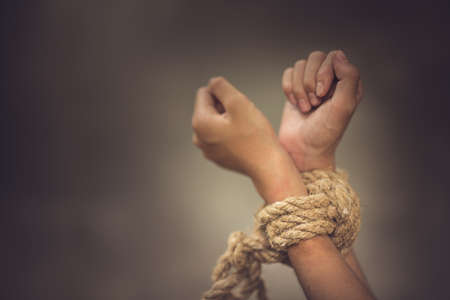 boy of a victim tied up with rope Stock Photo