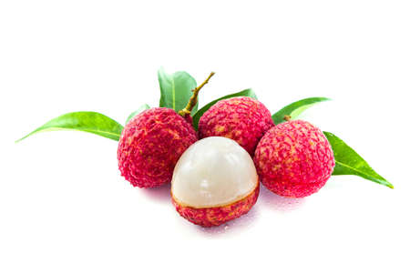 Sweet Lychees fruits with leaves close up isolated on white background Stock Photo