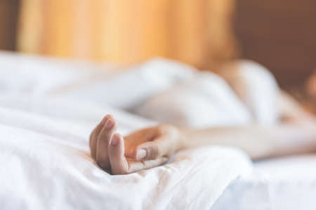 coercion: woman sit on a bed in a bedroom - concept photo of Sexual assault