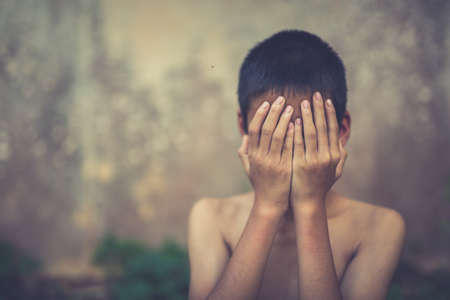 slave labor: Stop abusing boy violence. child bondage in angle image blur , Human Rights Day concept.