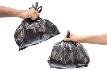 Man hands holding garbage bag isolated on white background