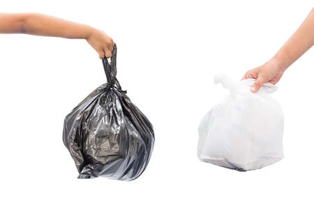 Female and children hand holding garbage bag isolated on white background Stock Photo