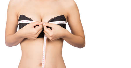 Women's breast measure, isolated for white background. photo
