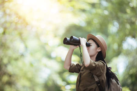 Hiking young woman with binoculars, Hiking concept. Hiking concept