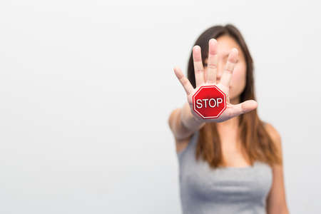 Stop, Woman standing with outstretched hand showing stop, Violence concept. Foto de archivo - 104520002