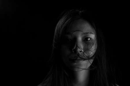 Human trafficking concept, End to violence against women, Scared woman with man's hand covering her neck, Victim of domestic violence.