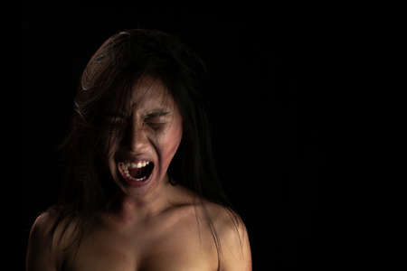 Screaming girl. Concept violence against  women 免版税图像
