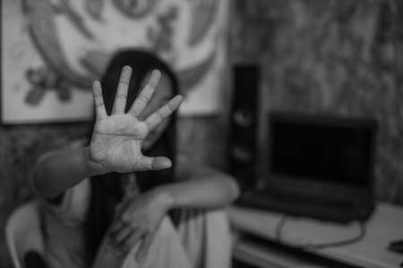Preventing violence against women, All talk and no action. Victim of domestic violence, Human trafficking concept, End to violence against women,Scared woman with man's hand covering her head, Sexual violence against women