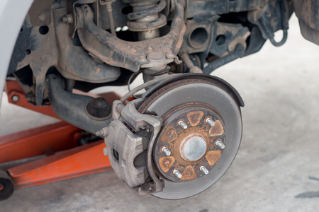 The absorber and the wheel of a car under repair