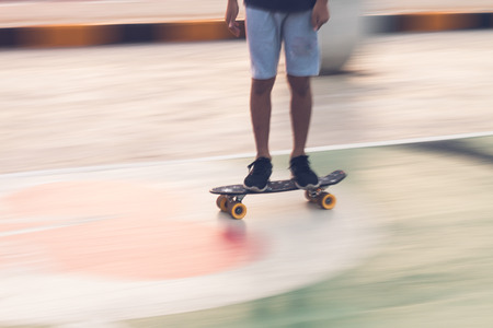 young play skate board panning is blur