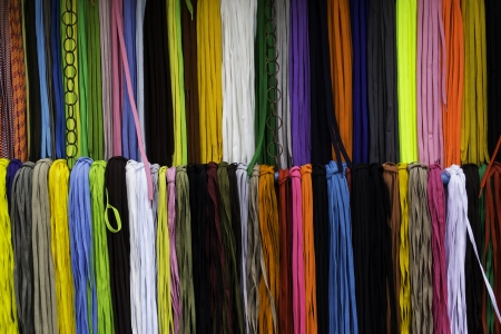 ornamente: Colorful shoestring hanging in a row