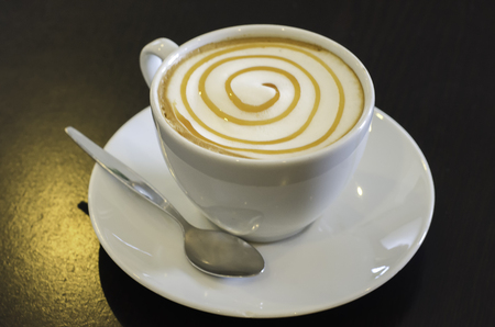 Cup of delicious hot cafe latte. Stock Photo