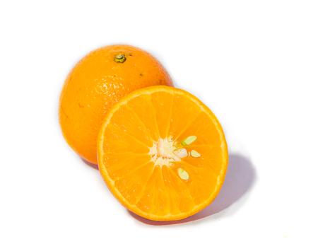 Glass of fresh orange juice,ripe orange fruit and slices on rustic wooden table.Freshly squeezed orange juice with drinking straw,orange fruit and orange slices.
