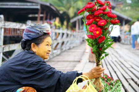 sangkhla buri: SANGKHLA BURI , KANCHANABURI, HTAILAND - DEC 31, 2008: unidentified women on Uttamanusorn Bridge, better known as Saphan Mon,  on December 31, 2008 in Kanchanaburi, THAILAND