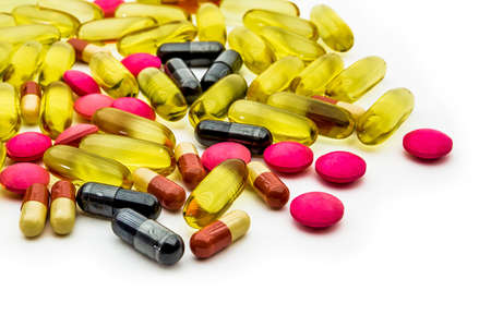 Close up fish oil,vitamins C and supplements capsules with white background.