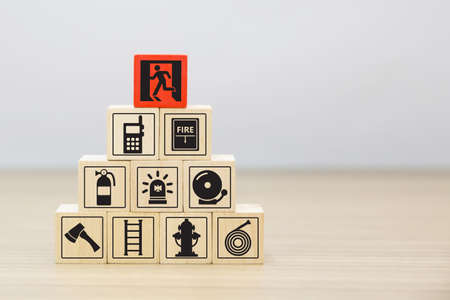 Wooded blocks Stacking with fire escape icon for safety concept.