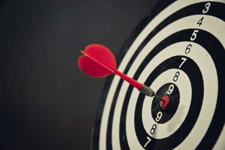 Dart hits center Bullseye is a target and goal of business, vintage style.