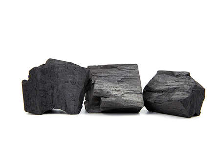 Natural wooden charcoal, Traditional or hard wood charcoal isolated on white background.