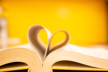 The pages in the book are heart-shaped in the library. Ideas for reading, studying, love and concentration.