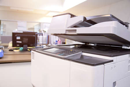 The photocopier or printer is office work tool equipment for scanning document and copy paper. Banque d'images
