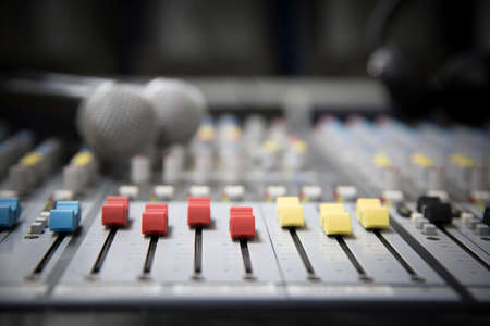 Close-up audio mixer in studio workplace for sound recording equipment and sound system instrument concept.