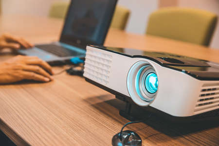 Projectors and computers installed on tables in the meeting boardroom. Standard-Bild - 156471367