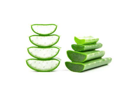 Slices of fresh aloe vera plant stacked and aloe vera stalk or leaves with water dropping isolate on white background.