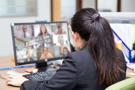 Female officer are using computer laptop for online meetings with conference program concepts of video call or online teaching students and eLearning.