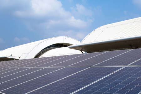 Close-up solar panels or solar roofs installed on the building rooftop. Standard-Bild - 156471623
