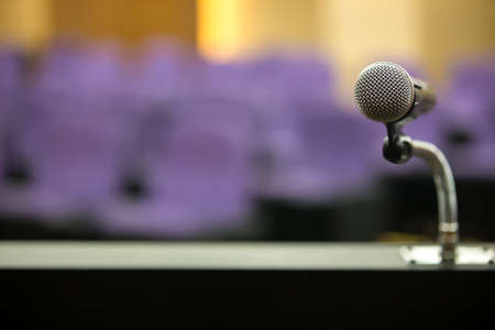 The microphones on the podium stand for public speaking welcoming or congratulations speech for work success background concept.