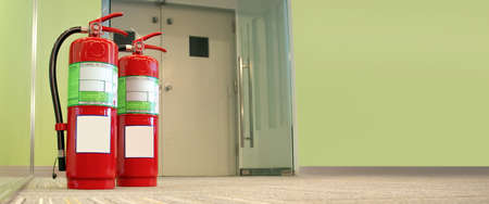 Close up the red fire extinguisher tank with fire exit door in the building concepts of emergency for prevent fire services and fire safety training and rescue.