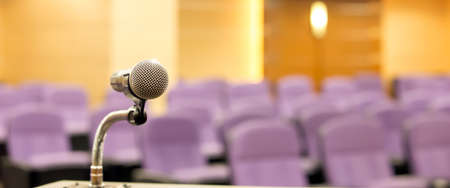 Public speaking backgrounds, Close-up the microphone on stand for speaker speech presentation stage performance with meeting seminar room blur background.