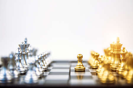 Close-up pawn chess standing first to challenge on chess board concepts of business team and leadership strategy and organization risk management or strategic plan and professional teamwork.