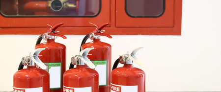 Close up the red fire extinguisher tank with fire hose cabinet in the building concepts of emergency for prevent fire services and fire safety training and rescue.