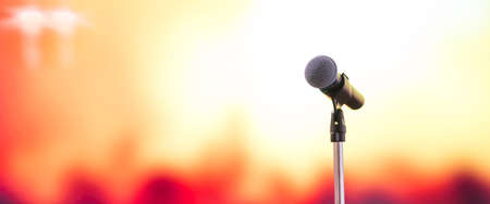Public speaking backgrounds, Close-up the microphone on stand for speaker speech at event hall with the blur peoples and light background.