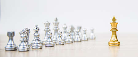 King chess standing with chess team in the back concepts of business team and leadership strategy and organization risk management.