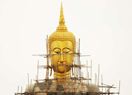 fascinate: Buddha Statue under restoration Stock Photo