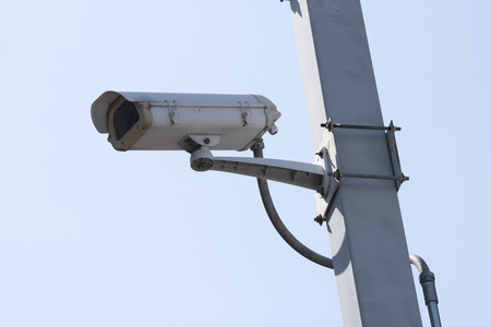 Outdoor CCTV Camera Operating for security in garden , on blue sky background 스톡 콘텐츠