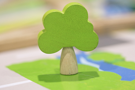 Woody toy green tree  - Play set Educational toys for preschool indoor playground (selective focus) Stock Photo