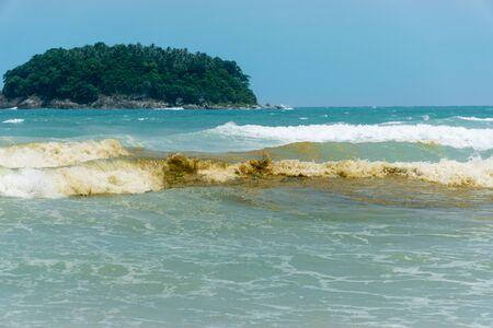 Waste water into the sea. brown colored sea water 版權商用圖片