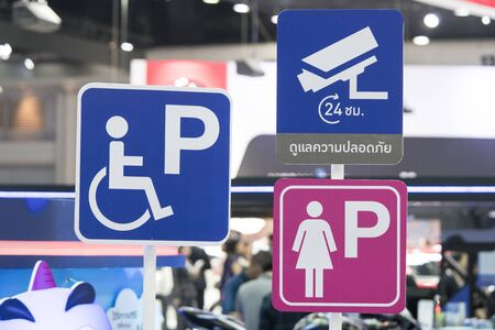 Sign of disabled parking - Signs symbols parking for women - 24 hours cctv/video surveillance warning sign Banco de Imagens