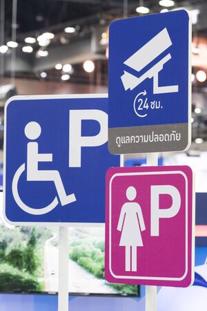 Sign of disabled parking - Signs symbols parking for women - 24 hours cctvvideo surveillance warning sign